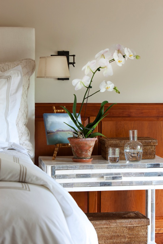 nightstand with art and orchids