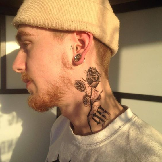 Rose tattoo on neck for men