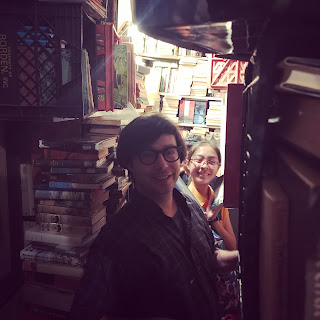 Greig Roselli and a companion browse at Arcadian Books & Prints on Orleans Street in the French Quarter