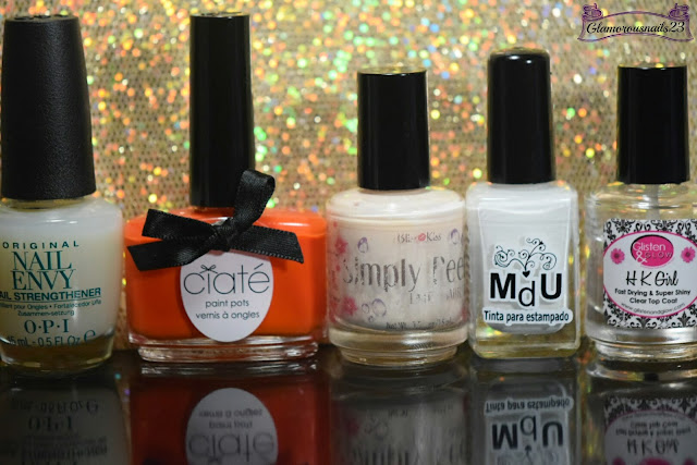 O.P.I Original Nail Envy, Ciaté Hopscotch, Bliss Kiss Simply Peel Latex Barrier, Mundo De Unas White, Glisten & Glow HK Girl Fast Drying Top Coat