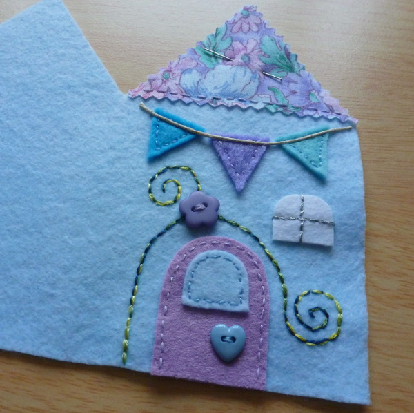 Front cover design on the felt needlebook case blue purple colors