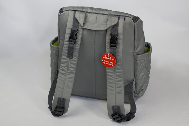 Showing the back pack straps and carry handle of the Skip Hop Forma