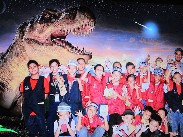 Children from Rumah Titian Kasih roaring into the Mesozoic Era