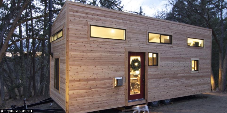 The tiny house sits on a 28-foot trailer. - This Couple Got Out Of The Rat Race. And Built This Tiny Home For $33K.
