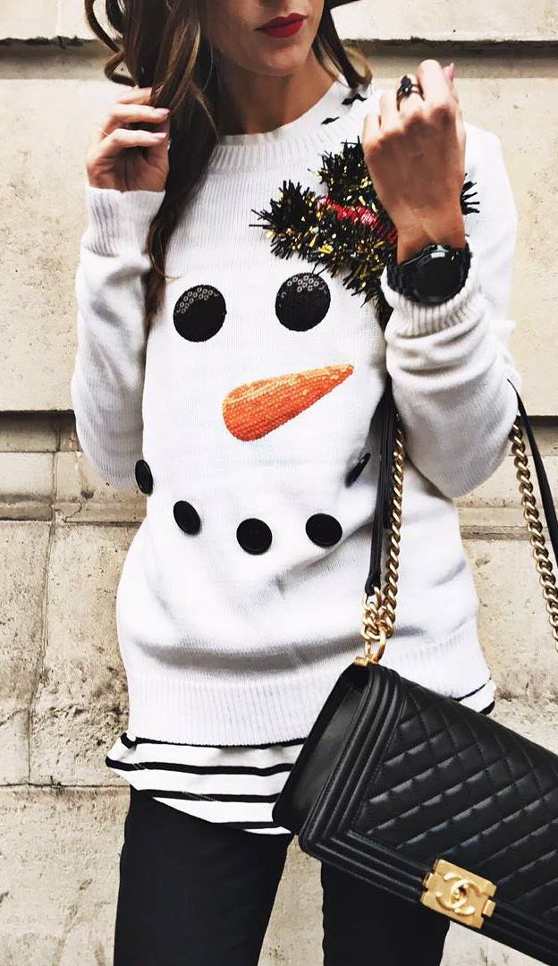 winter outfit inspiration /printed sweater + bag + stripped top + black pants