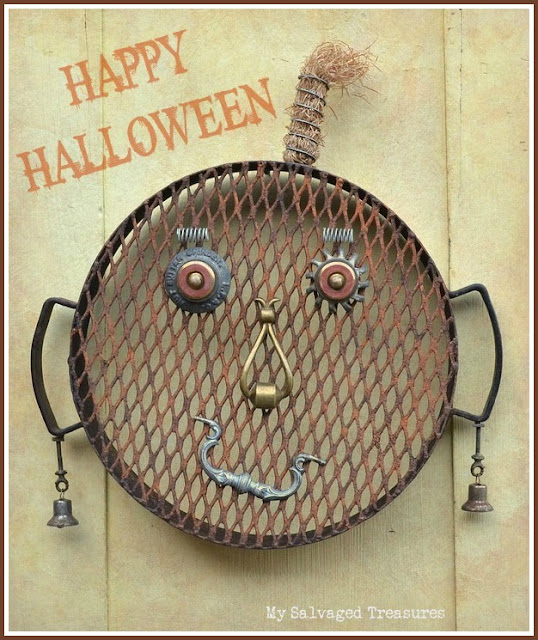 Happy Halloween repurposed junk pumpkin face