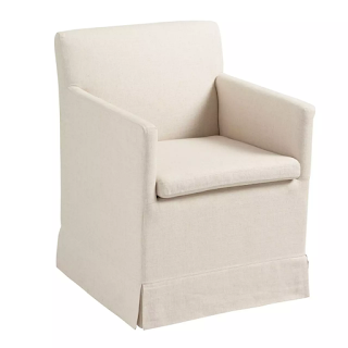 upholstered rolling dining chair in light fabric