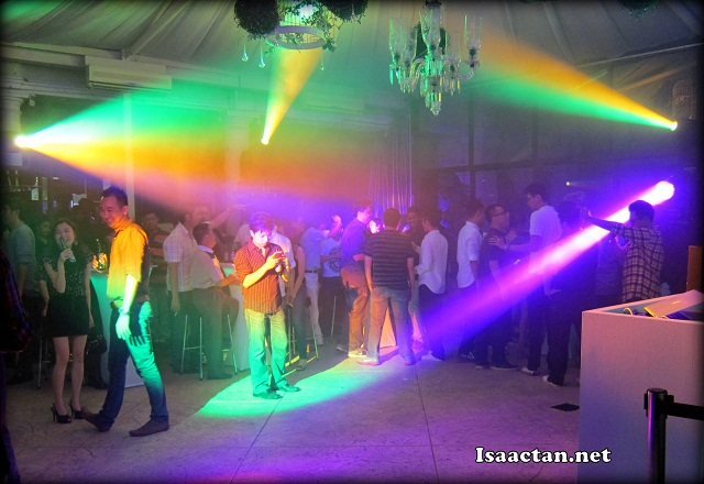 The dance floor at the beginning of the night with all the coloured beams