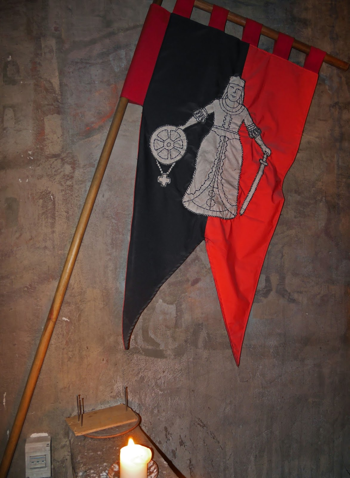 Medieval flag at the entrance to Rozengrāls Medieval Restaurant in Riga, Latvia