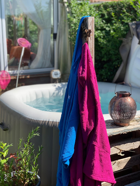 Hot tub with robes hanging on post