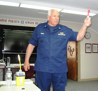 John Fisher demonstrates how to hold a flare