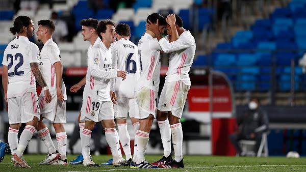 Real Madrid players Asensio and Militao celebrating goal against Osasuna