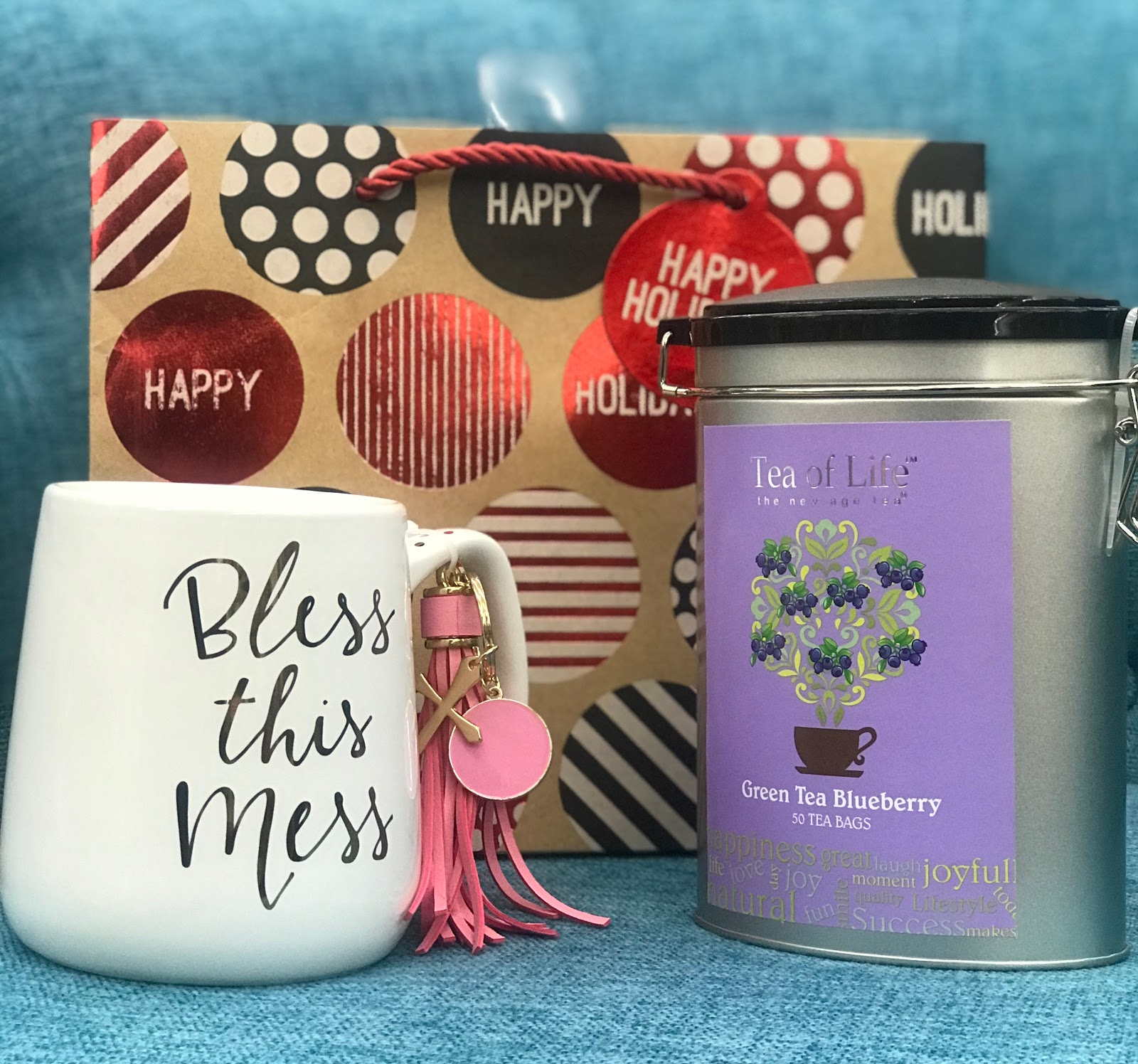 Gift wrapping coffee cup and a can of tea for gift giving ideas: Morning Babbles