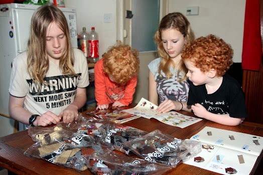 4 of my kids in January 2013 building a goblin king LEGO set