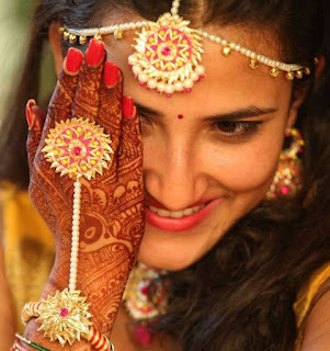 Image of a Indian Wedding Bride who Hide her Face which shows her shyness