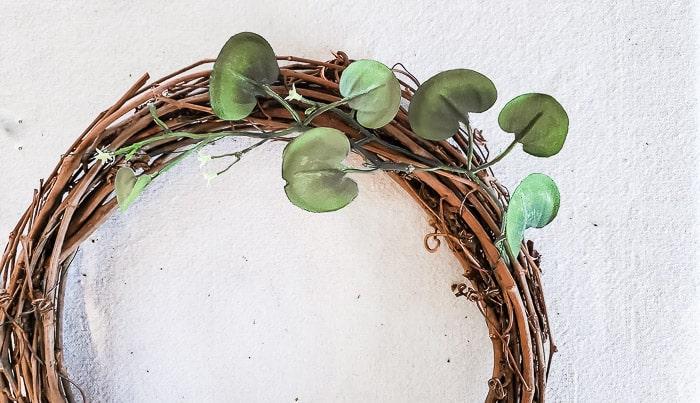 insert stems into grapevine wreath form