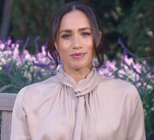 Meghan Markle wore a new pale dusty rose scarf-neck blouse, and gold swallow stud earrings drom Catherine Zoraida. Cartier Love yellow gold bracelet