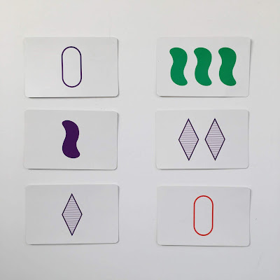 "Examples of two ""sets"" in the math game Set"