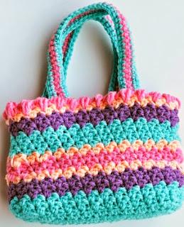 http://translate.google.es/translate?hl=es&sl=en&tl=es&u=http%3A%2F%2Fmymerrymessylife.com%2F2012%2F03%2Fcrochet-seed-stitch-purse-free-crochet-pattern.html