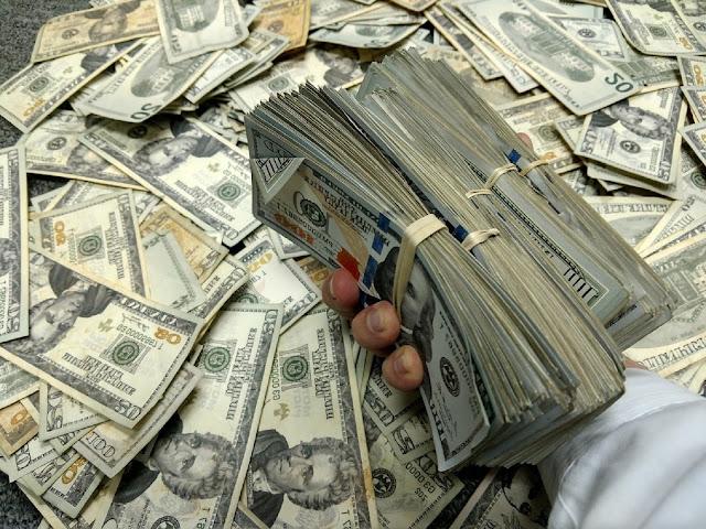 kelebihan-kekurangan-uang