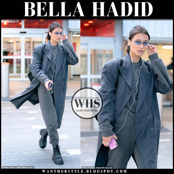 Bella Hadid in grey balenciaga coat and black prada monolith combat boots. celebrity airport style december 15