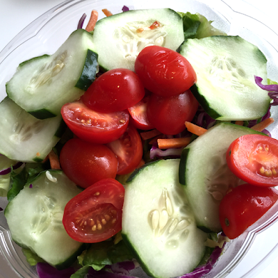 Fresh and vibrant salad at Nic's Organic Fast Food.