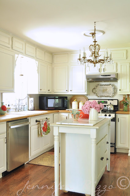 Pretty white kitchen with coral accents