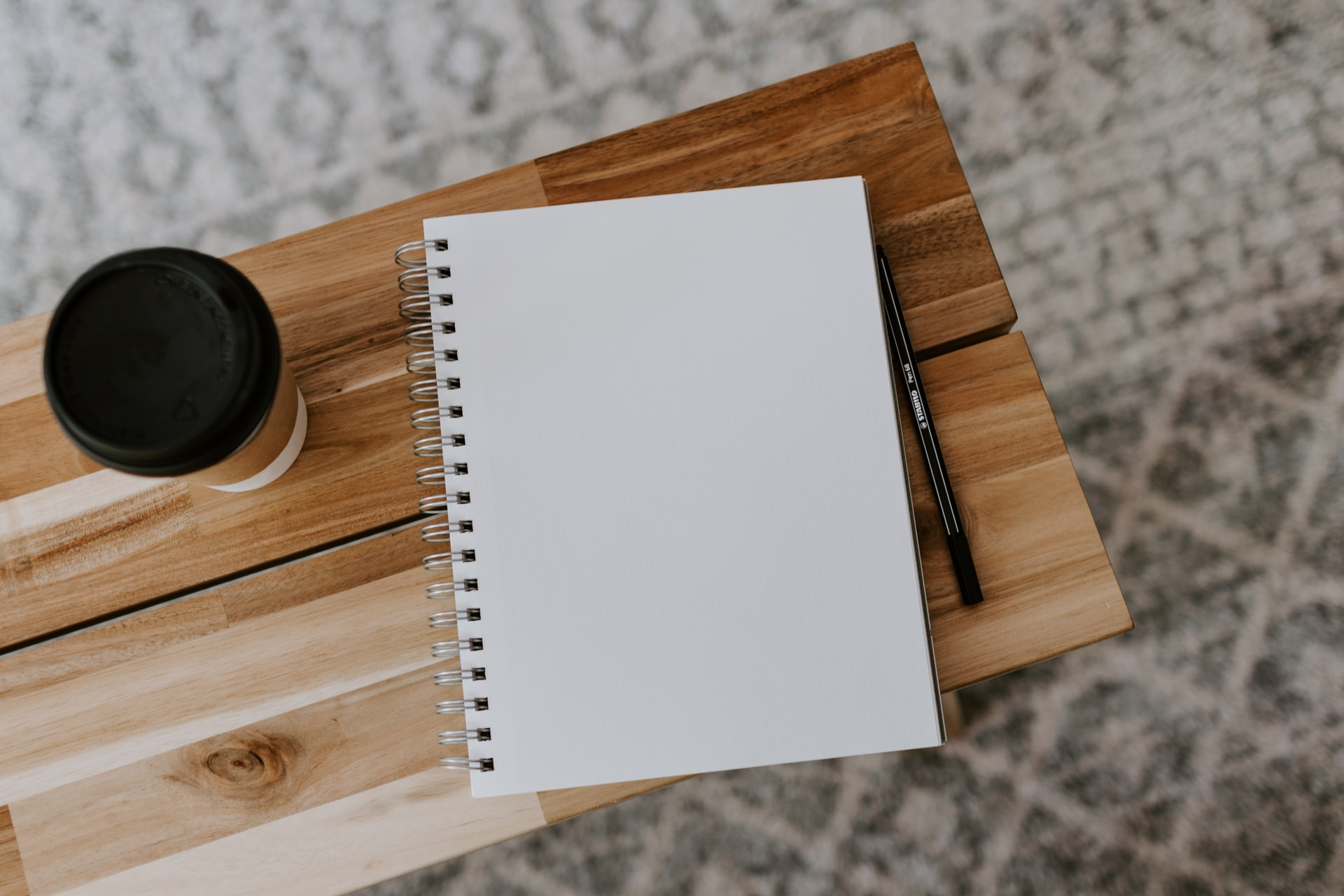 Notebook and coffee on desk