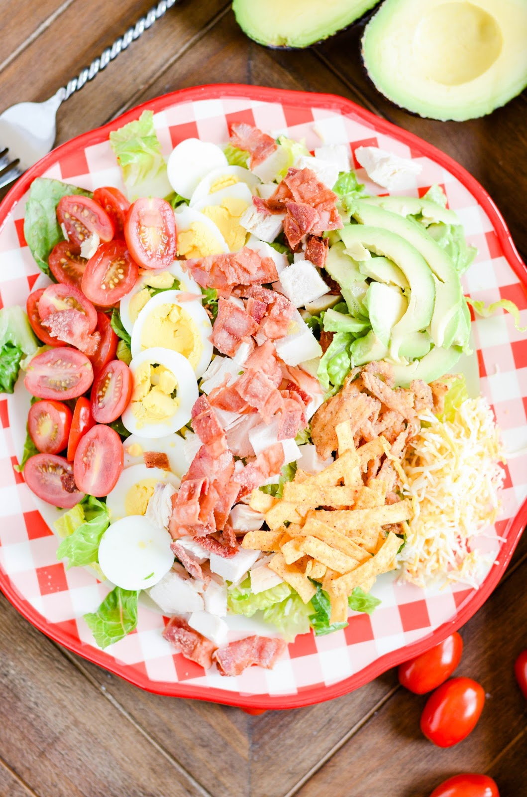 Perfect for warm weather, parties, lunch, and dinner! Crunchy, creamy, and just a little bit spicy BBQ Chicken Cobb Salad.