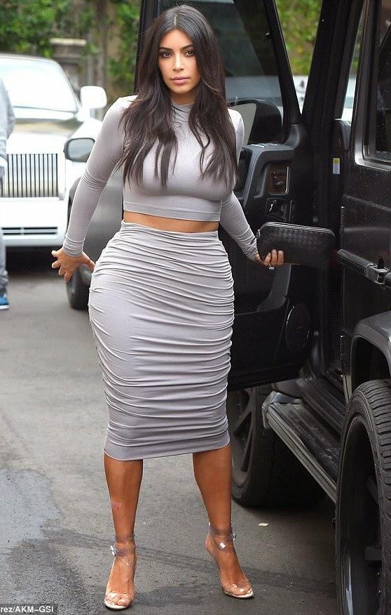 Kim & Khloe Kardashian put their big butt on display in tight outfits