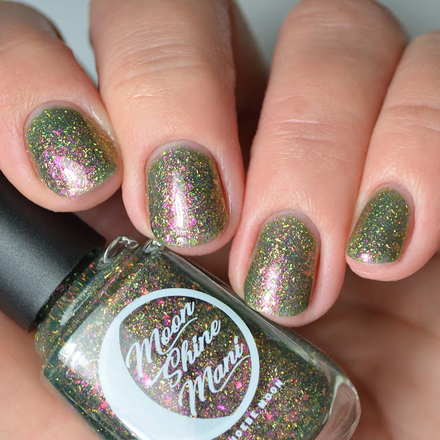 green nail polish with color shifting flakies four finger swatch