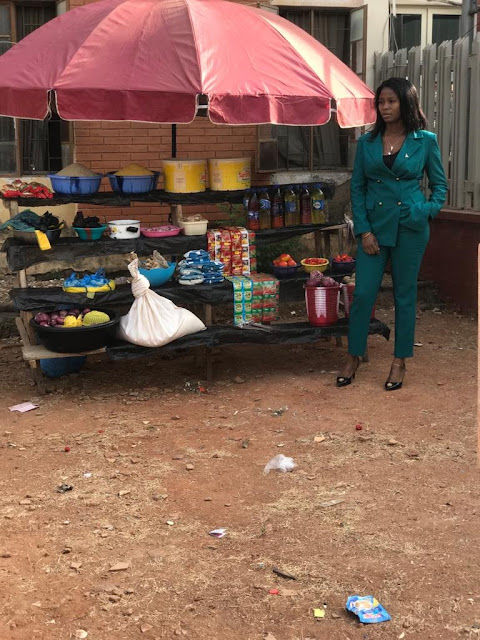 Nigerian Lady shows off her Corporate Outfit as she sells Foodstuffs in Abuja (Pictures)