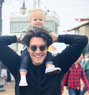 Picture of Peter Porte carrying a kid