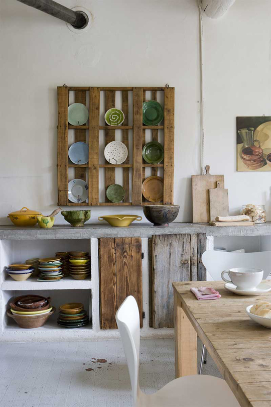 This recycled pallet is a great way to display dishes in your farmhouse kitchen
