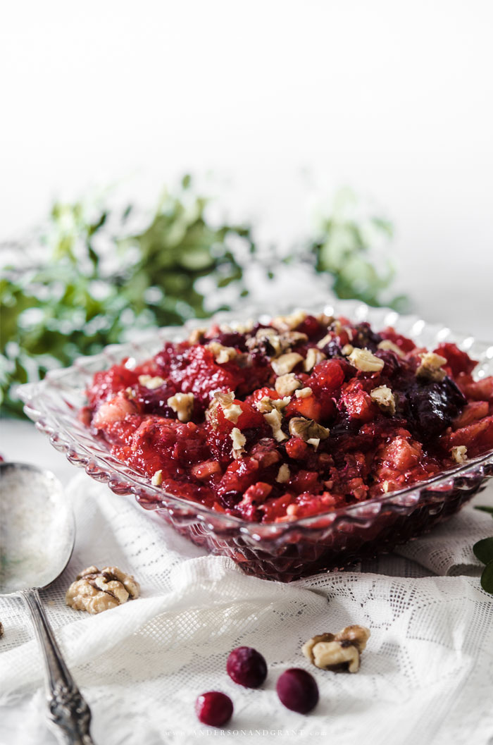 Bowl of cranberry jello salad with spoon