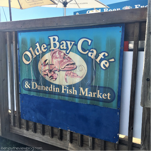 "old sign that says ""Olde Bay Cafe & Dunedin Fish Market"""