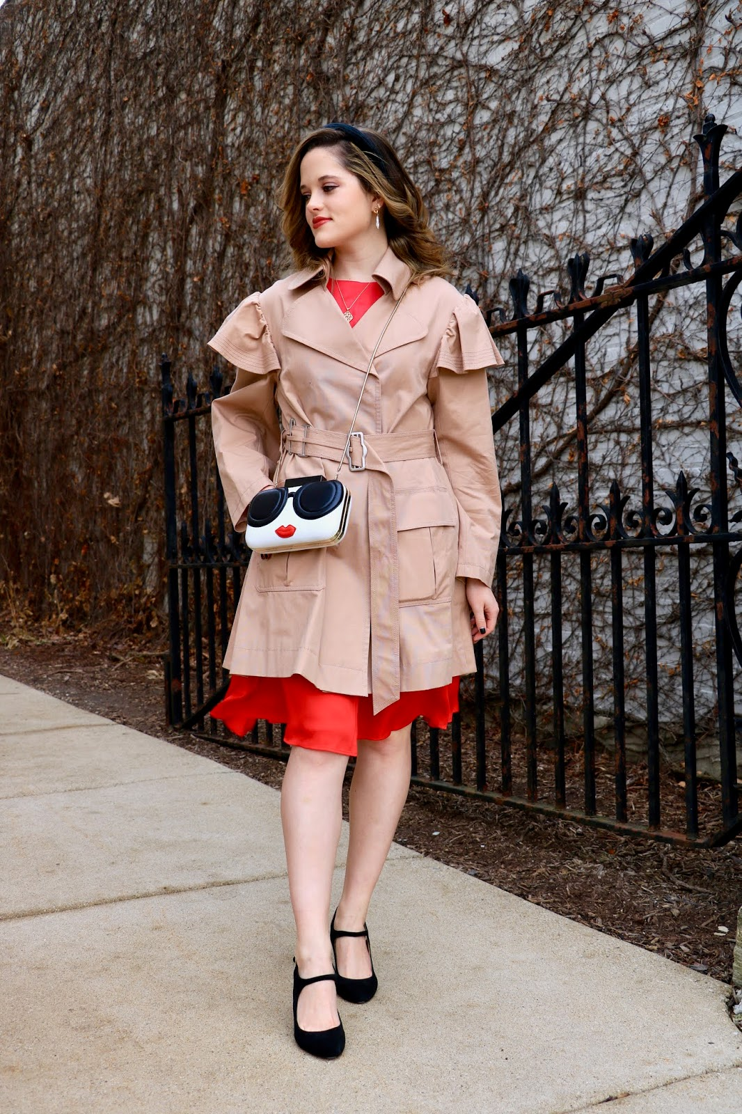 Nyc fashion blogger Kathleen Harper wearing a trench coat outfit in Winter.