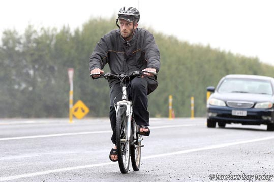 Terry Southey, Hastings, cycling along Pakowhai Rd, Hastings, in light showers, cool weather. While Hawke's Bay hosted a wet break in the high summer temperatures the Met Service says the rain is leaving us. An easterly breeze will push the precipitation inland. Normal summer weather patterns will resume as we climb back into the 30's early next week. photograph