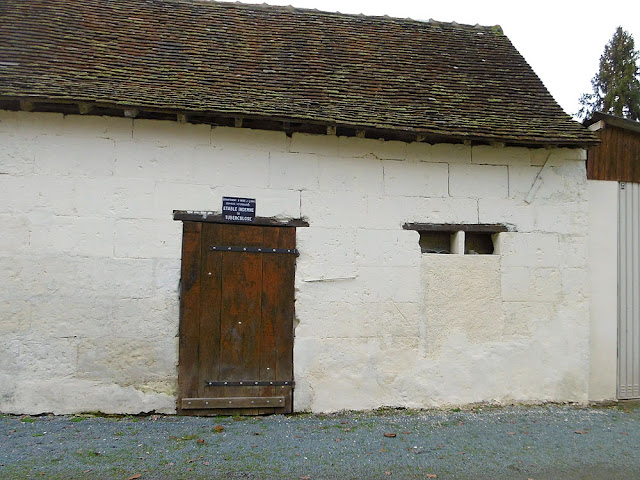 Barn with an old 'TB free' declaration above the door. Indre et Loire, France. Photo by Loire Valley Time Travel.