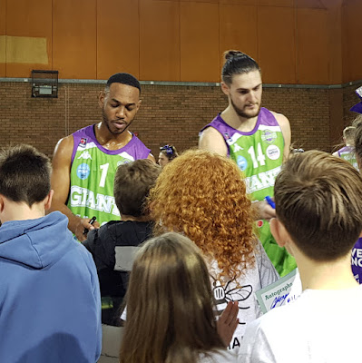 Manchester Giants Basketball squad signing autographs for children
