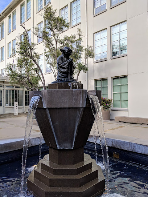 Water flows from this fountain topped with a Yoda statue.