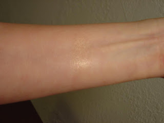 Swatch of Laura Geller Baked Gelato Swirl Illuminator (Gilded Honey).jpeg