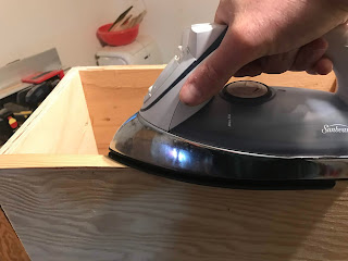 Heating the veneer with the iron