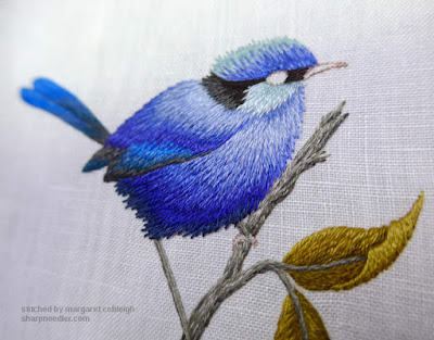 Embroidered blue bird nearly finished. The eye is next.