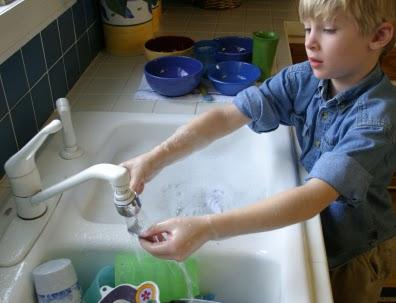 NAMC Montessori normalization elementary teacher child washing dishes