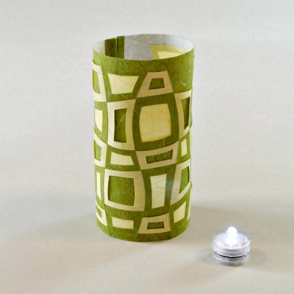 woven Japanese paper lantern with battery operated candle