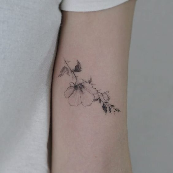 What is the meaning of the magnolia flower tattoo pattern?
