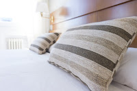 An image showing two comfortable pillows which are placed on a bed