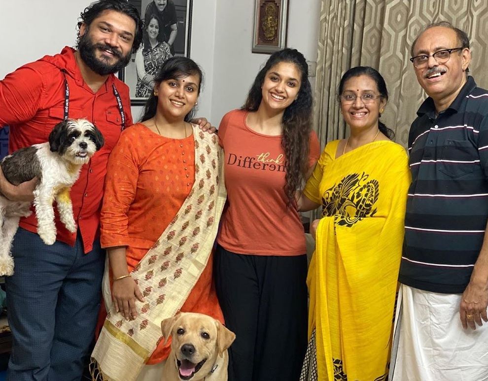 Keerthy Suresh with Lovely Smile along with her Lovely Family