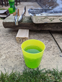 A Disposable BBQ and a drink (Yes I know it's bright green!)